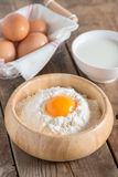 Egg yolk in the flour. Royalty Free Stock Images