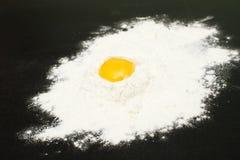 An egg yolk in the flour Royalty Free Stock Photos