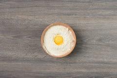 Egg yolk in flour Stock Photos