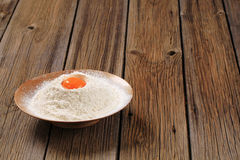 Egg yolk and flour Royalty Free Stock Image