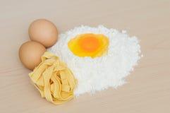 Egg yolk on flour Royalty Free Stock Images