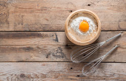 Egg yolk in the flour and whip for beating on wood table. Top vi Royalty Free Stock Images