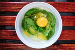 Egg Yolk on Sweet Basil Stock Photo