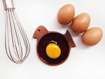 Egg yolk on wooden bird shaped saucer Stock Images