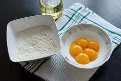 Egg yolks and flour Stock Image