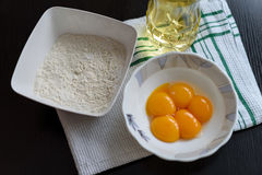 Egg yolks and flour. Five egg yolks and flour Royalty Free Stock Images