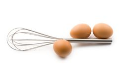 Eggbeater and eggs Stock Photo