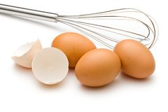 Eggbeater and eggs Stock Image