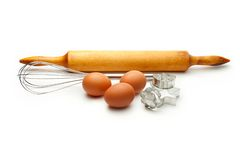 Eggbeater and eggs Stock Images