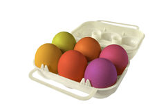 Eggbox whith colored eggs Stock Photos