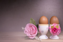 Eggcup and boiled egg, on wooden table. Stock Photo