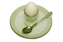 Eggcup with the egg on the plate. Eggcup with the egg and spoon on the plate Royalty Free Stock Photos