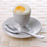 Eggcup and spoon Stock Photos