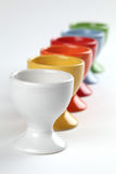 Eggcups. Close-up of a row of colorful eggcups. Shallow dof Royalty Free Stock Photography