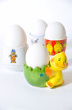 Eggcups. Four white eggs and eggcups Royalty Free Stock Image