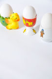 Eggcups. Three white eggs and eggcups Stock Photography