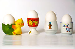 Eggcups. Four white eggs and eggcups Stock Photo