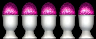 Eggcups with pink easter eggs. Five eggcups containg pink easter eggs Royalty Free Stock Photo