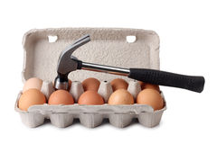 Egges and hammer Stock Images