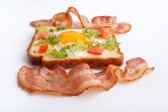 Eggie bread and fried bacon Royalty Free Stock Images
