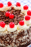 Eggless Blackforest cake. Blackforest Chocolate cake with white butter cream ganache,chocolate flakes and cut morello cherries decoration royalty free stock photos
