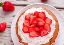 Eggless cake. From India with strawberries and whipped cream close up top view Stock Photography