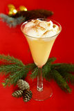 Eggnog. Glass of eggnog with whipped cream on red background Royalty Free Stock Images