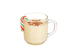 Eggnog with a candy cane Stock Images