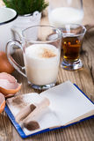 Eggnog  for Christmas, ingredients on rustic wooden table, recip Stock Image