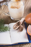 Eggnog  for Christmas, ingredients on rustic wooden table, recip Royalty Free Stock Photo