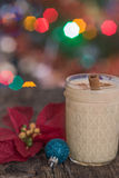 Eggnog in Christmas setting. Egg nog in a jar with Christmas lights in the background Royalty Free Stock Photo