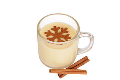 Eggnog with cinnamon snowflake Stock Photos