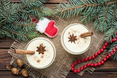 Eggnog cocktail in glasses arranged with christmas decoration on Royalty Free Stock Photography