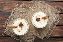 Eggnog cocktail in glasses arranged with christmas decoration on Royalty Free Stock Images