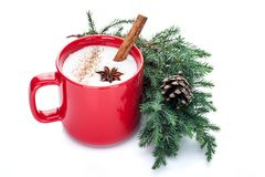 Eggnog cocktail in red mug arranged with christmas decoration is royalty free stock image