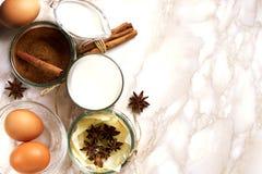 Eggnog ingredients on table Royalty Free Stock Image