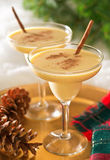 Eggnog. Two delicious eggnog cocktails with cinnamon sticks and cinnamon garnish Royalty Free Stock Photo