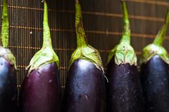 Eggplant. Closeup of many eggplant in table royalty free stock image