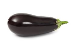 Eggplant. Photo of an eggplant over white background. Shadow visible royalty free stock photos