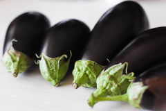 Eggplant. Closeup of many eggplant in table royalty free stock images