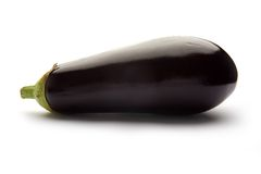 Eggplant or aubergine. Eggplant or aubergine on a white studio background Royalty Free Stock Photos
