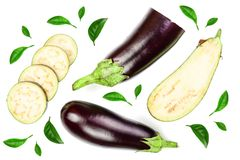 Eggplant or aubergine isolated on white background decorated with green leaves. Top view. Flat lay pattern Stock Photos