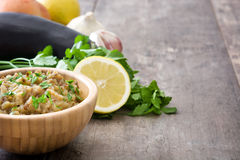 Eggplant baba ganoush in bowl and ingredients Stock Photos