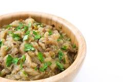Eggplant baba ganoush in bowl isolated Royalty Free Stock Images