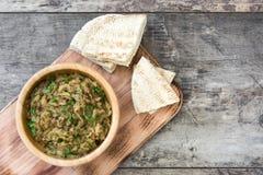 Eggplant baba ganoush and pita bread on wood Stock Images