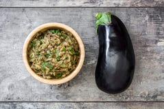 Eggplant baba ganoush on wood Stock Images