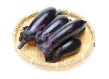 Eggplant on a bamboo colander Stock Photo