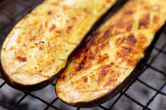 Eggplant being fried on grill Stock Photo
