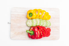 Eggplant and bell pepper Yellow and red sliced on wooden board Stock Photo