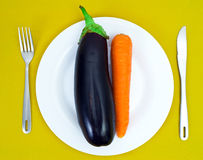Eggplant and carrot. On a white plate Stock Photo